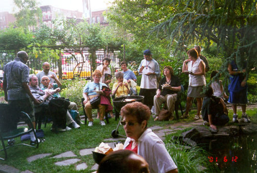 A barbecue attended by people of all ages at the Liz Christy Community Garden in 2001. Retrieved from http://www.ecotippingpoints.org